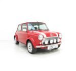 A Striking Mini Classic Cooper Sport Pack with Just 21,400 Miles.